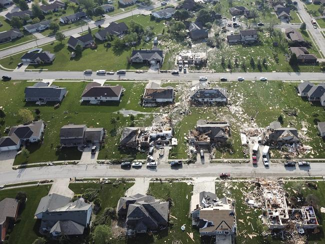 Houses in Celina, Ohio are obliterated while their neighbours remain in tact. Picture: Ryan Snyder/Daily Standard via AP.