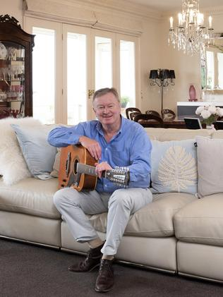 Walter relaxes at home with his guitar.
