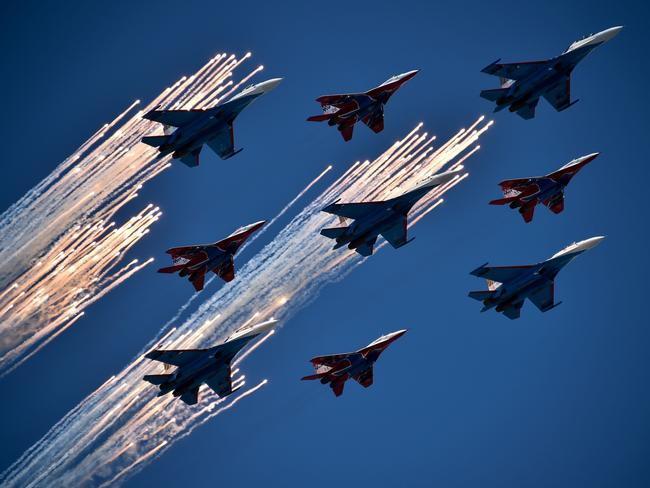 Russian Su-27 jet fighters and MIG 29 jet fighters fly over Red Square during the Victory Day military parade in Moscow. Picture: Kirill Kudryavtsev