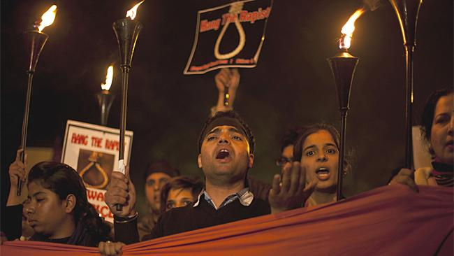 Indians shout slogans and march on a street as they mourn the death of a gang rape victim in New Delhi, India, on Saturday. Picture: AP