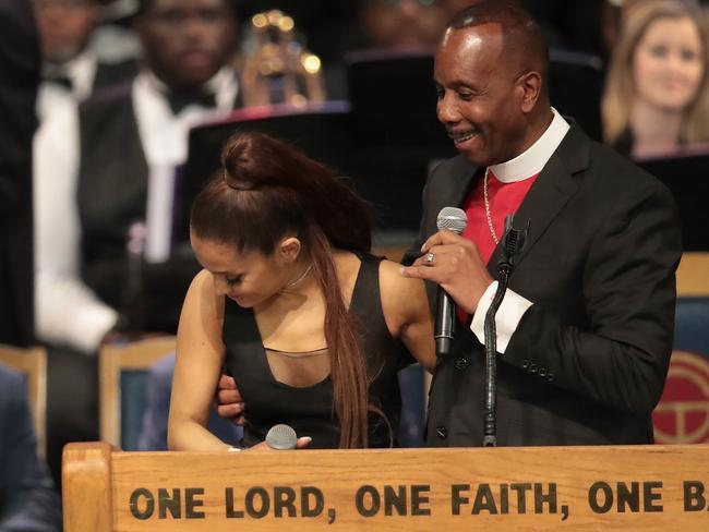 Bishop Charles Ellis chats with Ariana Grande after her performance at the funeral for Aretha Franklin. Picture: Scott Olson/Getty Images/AFP