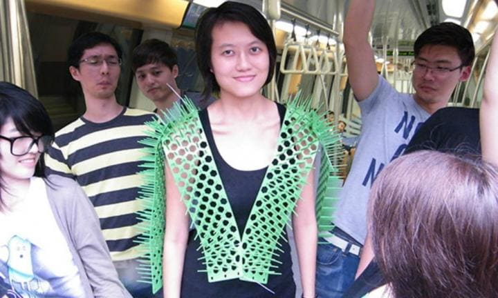 11. THE 'GIVE ME SPACE' SUIT  <p>Sick of people invading your personal space on public transport while on your way to and from work? This spiked vest will be sure to keep people away. Just look at the faces on the people around her!</p>