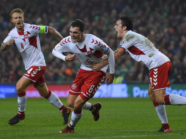Andreas Christensen of Denmark (centre) celebrates.