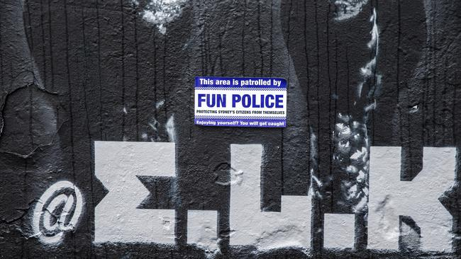 A sticker is seen on a mural by artist Luke Cornish after a backlash by locals called for its removal. Picture: Getty Images