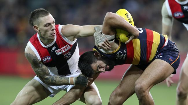 Adelaide's Wayne Milera under pressure from St Kilda's Matthew Parker. Picture: Sarah Reed
