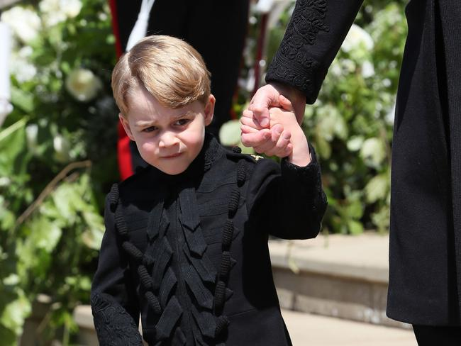 Prince George in a mini version of Prince Harry's outfit. Picture: Brian Lawless — WPA Pool/Getty Images.
