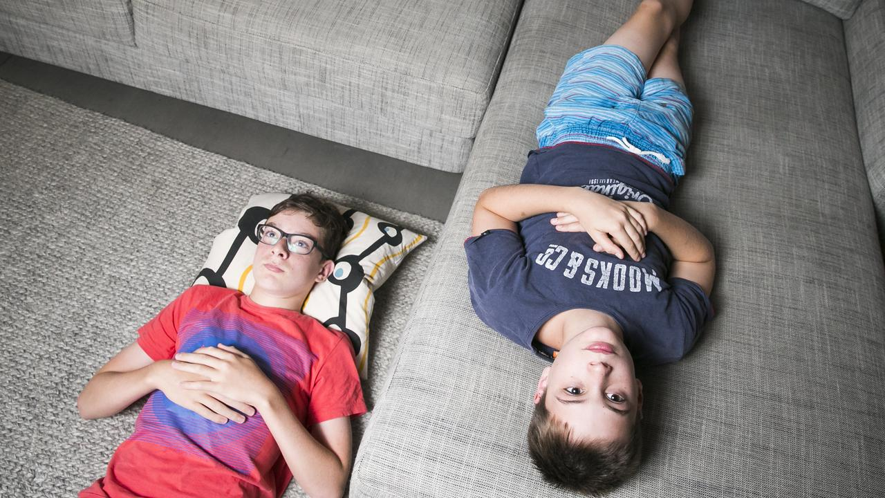 Friends Samual and Hugh, both 13, bored at home. Picture: Dylan Robinson