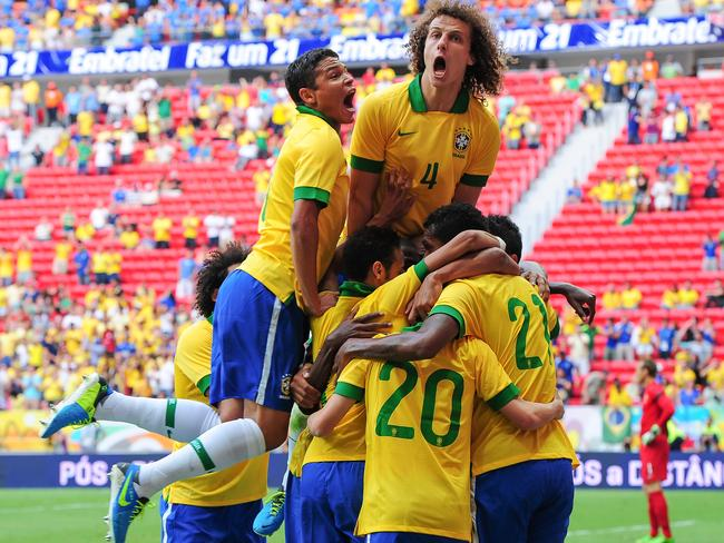 David Luiz celebrates the win four years ago.