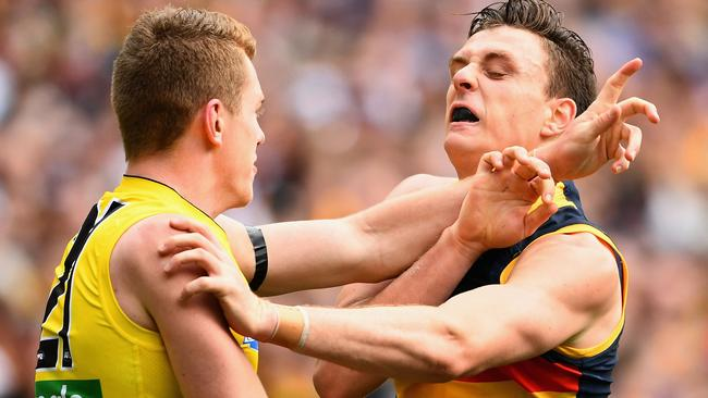 Jacob Townsend gets in Jake Lever's face.