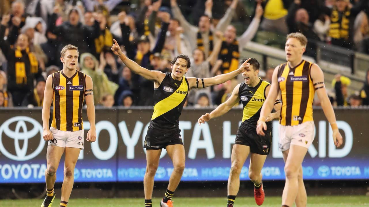 Daniel Rioli celebrates one of his three goals on Thursday night.