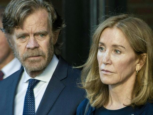 Actress Felicity Huffman, with husband, actor William H. Macy, received a two-week prison term for her role in a college admissions scam. Picture: Getty Images