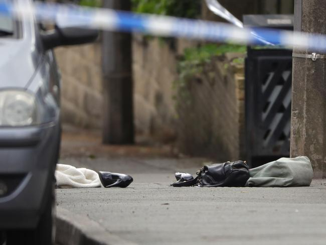 A handbag and shoes lie on the ground as police cordon off an area after Jo Cox, 41, Labour MP for Batley and Spen, was shot and stabbed by an attacker. Picture: Getty