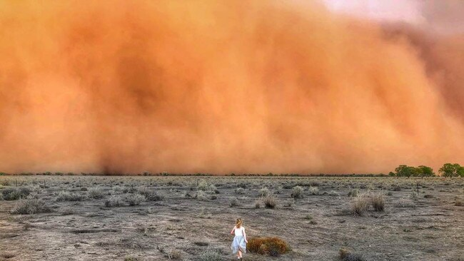 Marcia Macmillan's daughter braves the dust storm.