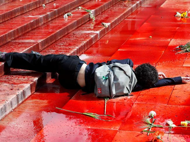 A member of Extinction Rebellion lies on the ground in fake blood on the Trocadero esplanade in Paris. Picture: Francois Guillot/AFP