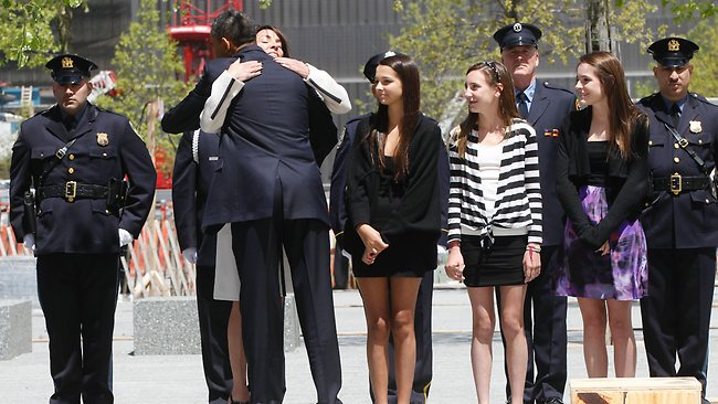 Obama hugs Diane Wall, mother of 14-year-old Payton Wall, and wife of Glen James Wall, who died during the World Trade Centre attacks. Picture: AP