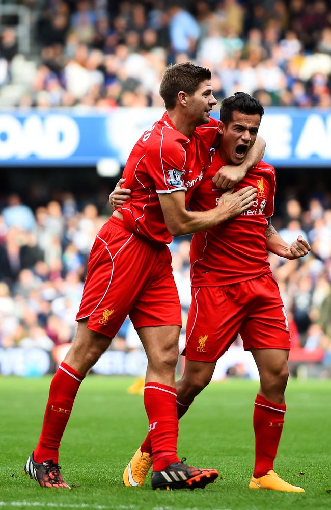 Philippe Coutinho of Liverpool celebrates with teammate Steven Gerrard.