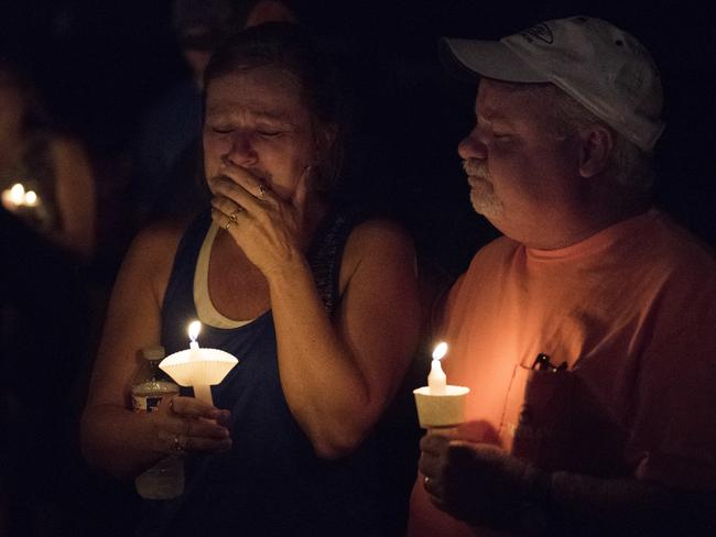 Mourners at a candlelight vigil for the victims of a fatal shooting at the First Baptist Church of Sutherland Springs in Texas. Picture: Darren Abate/AP Photo