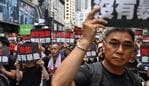 Protesters march during a rally against a controversial extradition law proposal in Hong Kong on June 16, 2019. - Large crowds gathered in Hong Kong for a mass rally on June 16 as public anger seethed following unprecedented clashes between protesters and police over an extradition law, despite a climbdown by the city's embattled leader. (Photo by Hector RETAMAL / AFP)