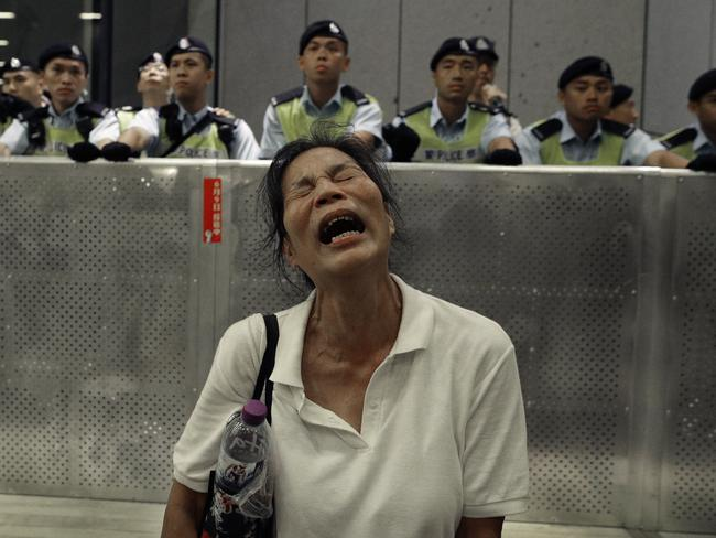 A protester reacts as police officers clash with protesters. Picture: Vincent Yu/AP