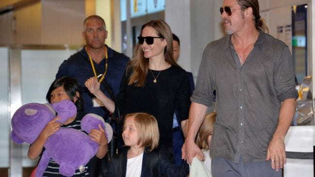 Brad and Angelina with their kids during happier times. Photo: AFP/Yoshikazu Tsuno