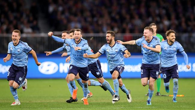 Sydney FC players after the penalty shootout in the 2019 A-League grand final in Perth.