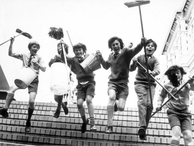 Sacred Heart College Year 7 students high on chocolate frogs, Toobs and licorice demand more sugar while brandishing cleaning implements in 1977. Picture from the book 'The Endless Playground, celebrating Australian childhood'