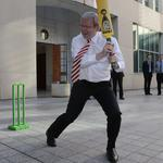 Kevin Rudd shows off his cricketing ability to the Australian Test cricket team in the courtyard of his office at Parliament House in Canberra in 2008.