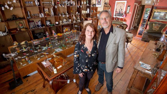 Cherie Bridges and Mark Payne inside the store they've listed for sale. Picture: Jay Town