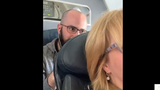 Two people became locked in an intense mid-air battle over a reclining seat. Picture: @steelersfanOG
