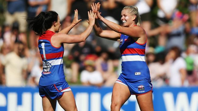 Brooke Lochland and Katie Brennan celebrate during the Western Bulldogs' win over Fremantle. (Photo by Michael Dodge/Getty Images)