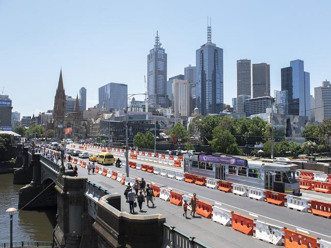 Safety barriers have been installed in the middle of Melbourne's Princes Bridge in preparation for New Years Eve. Picture: Ellen Smith