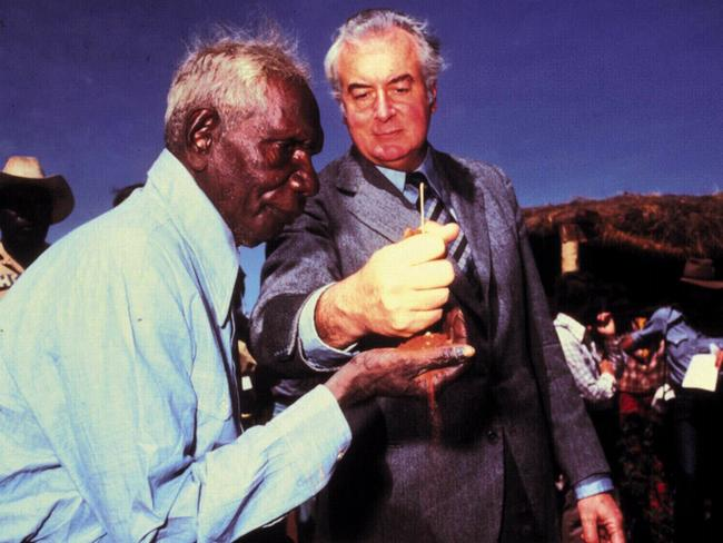 Historic moment ... Gough Whitlam pours sand into hand of Vincent Lingiari during the 1975 handover of traditional Gurindji land at Wave Hill. Picture: News Corp Australia.