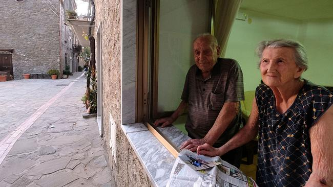 Italian Antonio Vassallo, 100 years-old, and his wife Amina Fedollo, 93, pose in their house in Acciaroli, southern Italy, Picture: Mario Laporta/AFP