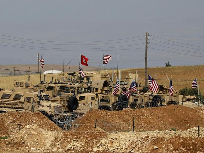Vehicles of US-backed coalition forces in the northern Syrian town of Manbij. Picture: AFP