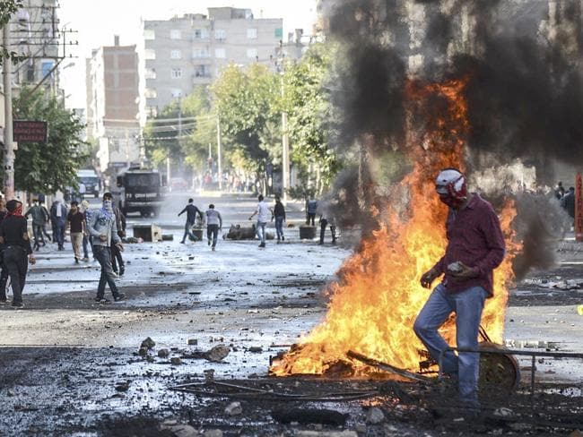 Key town ... Kurdish protesters clash with Turkish riot policemen in the south-eastern city of Diyarbakir. reports indicate the key Syrian border town of Ain al-Arab (Kobane) is about to fall to IS. Picture: AFP PHOTO /ILYAS AKENGIN