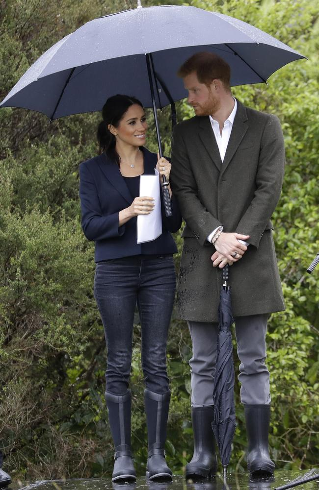 Yesterday he held the umbrella for her, today she's holding it for him. TEAMWORK. Picture: AP