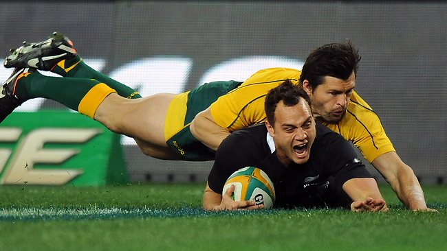 Israel Dagg from New Zealand (below) is tackled by Australia's Adam Ashley-Cooper as he scores a try during the Bledisloe Cup rugby union test in Sydney.