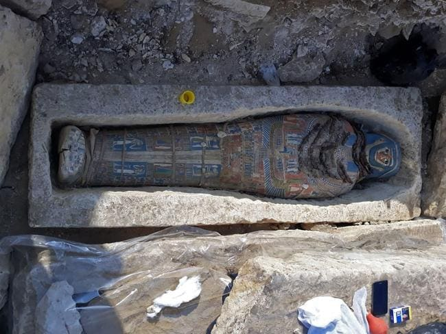 A newly-uncovered mummy, dating back over 2,300 years, found by Egyptian archaeologists at a pyramid complex south of Cairo Picture: AFP