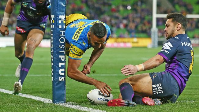 Bevan French of the Eels scores against the Storm.