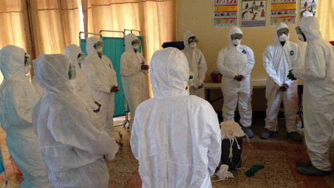 Health workers at Georgetown University Medical Center are trained how to properly use protective gear to protect against the Ebola virus in the US. (AP Photo/Dan Lucey)