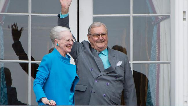 Danish Queen Margrethe and Prince Henrik greeting wellwishers from the balcony of their palace in April 2016. Picture: AFP