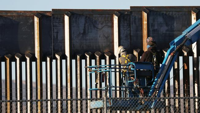 Workers at the US/Mexican border wall. Picture: Getty Images/AFP