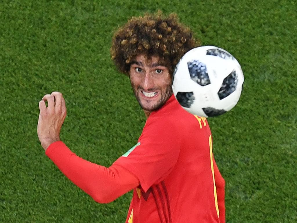 Belgium's midfielder Marouane Fellaini jumps to head the ball during the Russia 2018 World Cup Group G football match between England and Belgium at the Kaliningrad Stadium in Kaliningrad on June 28, 2018.  / AFP PHOTO / Kirill KUDRYAVTSEV / RESTRICTED TO EDITORIAL USE - NO MOBILE PUSH ALERTS/DOWNLOADS