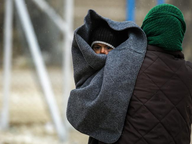 A displaced Syrian woman, fleeing from Islamic State (IS) group fighters. Norway's government has collapsed over a decision to repatriate one such woman. Picture: AFP