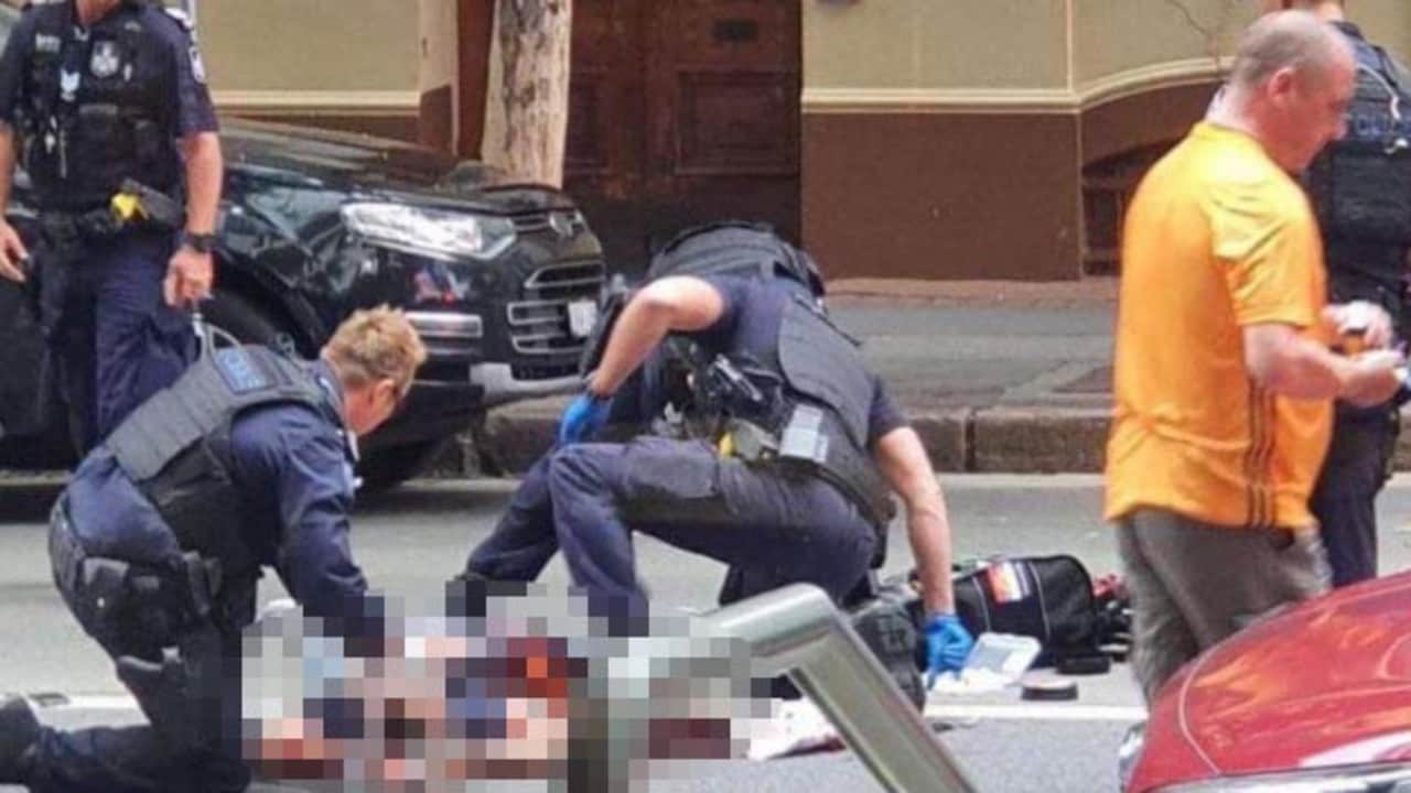 Emergency services work on the man shot dead in the Brisbane CBD. Picture: Supplied