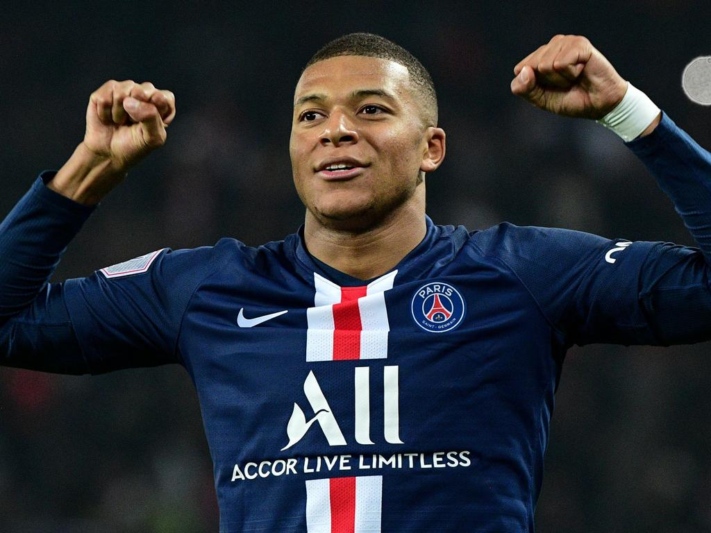 Paris Saint-Germain's French forward Kylian Mbappe celebrates after scoring his team's third goal during the French L1 football match between Paris Saint-Germain (PSG) and Olympique de Marseille (OM) at the Parc des Princes stadium in Paris on October 27, 2019. (Photo by Martin BUREAU / AFP)