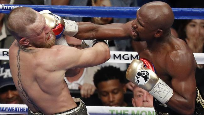 Floyd Mayweather Jr. hits Conor McGregor.
