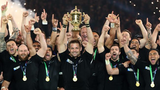 Richie McCaw of New Zealand lifts the Webb Ellis Cup.