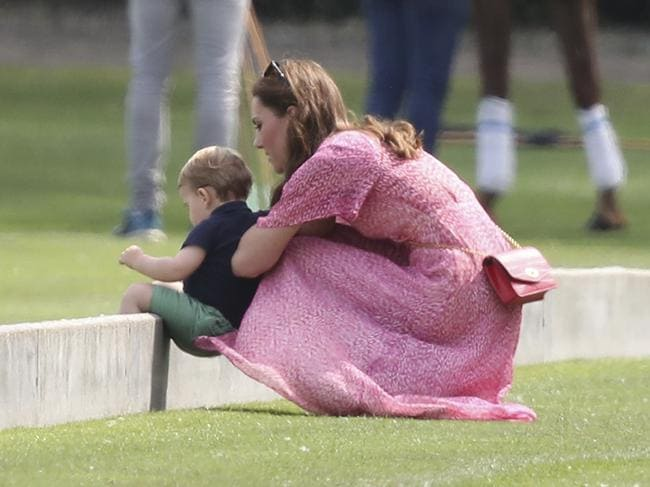 Britain's Kate, Duchess of Cambridge and Prince Louis play on the grass. Picture: Andrew Matthews/PA via AP.