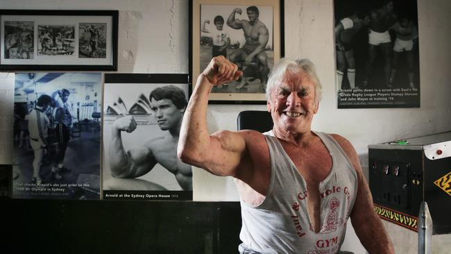 Body builder Paul Graham pictured at his Woollahra home with pictures of his good friend Arnold Schwarzenegger. Picture: Toby Zerna